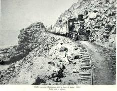 Kinau-nearing Mahukona with a narrow gauge train loaded with sugar - 1882
