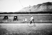 Man riding a bike on the Kapi'olani race track-(waikikivisitor-com)