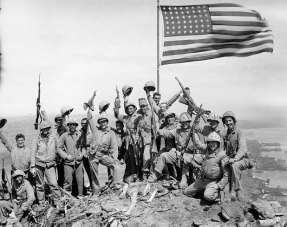 Marines and Navy Corpsman from Easy Company 2nd Battalion 28th Marines after raising the flags on Mt. Suribachi-Iwo Jima February 23, 1945