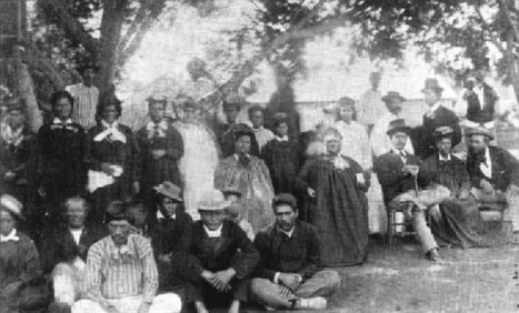 Princess Ruth Keelikolani (right of center) with her son (seated to her left) Prince Leleiohoku II