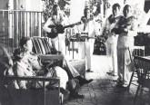 Amelia Earhart & husband George Putnam are serenaded by Royal Hawaiian Hotel musicians 1-2-1935