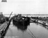 Refloated battleship enters drydock-12-28-1943