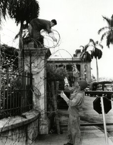 U.S. soldiers surround Iolani Palace with barbed wire during the rule of martial law in 1942