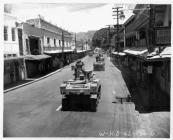 US Army M3 Stuart light tanks in maneuvers, Beretania Street in the Honolulu business district, Hawaii, 30 August 1942