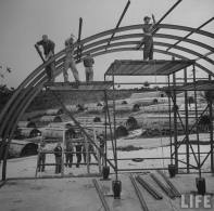 US Navy Seabees building quonset huts. Guam, June 1945