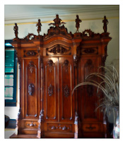 Wardrobe commissioned by King Kalākaua made of koa & trimmed with darker kou-made from Koa grown at Iolani Palace (huliheepalace-net)