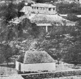 White building in the front is old royal Mausoleum-Pohukaina. Wooden building behind it is original ʻIolani Palace