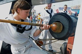 090915-N-9824T-227 YORK, Pa. (Sept. 15, 2009) Seaman Sarah Rickett, assigned to USS Constitution, demonstrates how Sailors in the past would prepare a cannon for firing. The gun drill demonstration by the Constitution crew was one of many Navy events scheduled during York Navy Week, one of 21 Navy Weeks planned across America in 2009. Navy Week is designed to show Americans the investment they have made in their Navy and increase awareness in metropolitan areas that do not have a significant Navy presence. (U.S. Navy photo by Mass Communication Specialist 2nd Class Devin Thorpe/Released)