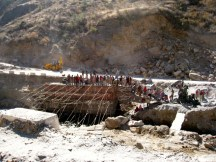 Indian labourers building a new bridge by hand in Bhutan