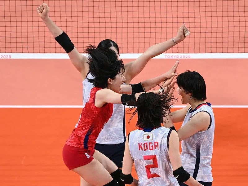 Japan celebrate a point against Sourth Korea in their volleyball clash