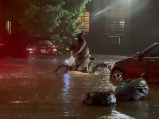 NYC Photog on Mission to Find Delivery Man Who Waded Through Ida Floods 2