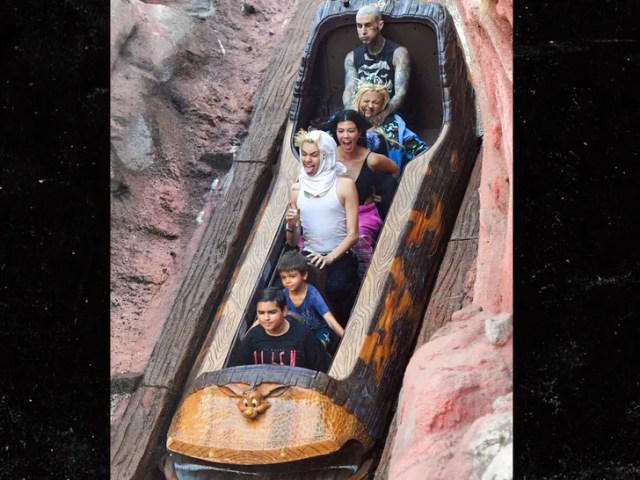 Kourtney Kardashian and Travis Barker take their love to Disneyland