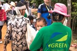 Pink hat, green worker