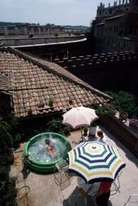 A married Swiss Guard and his family enjoy a patio pool at their compound in Vatican City, 1985.