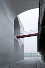 54336c81c07a8024cc0000e6_long-museum-west-bund-atelier-deshaus_alley_through_the_museum03