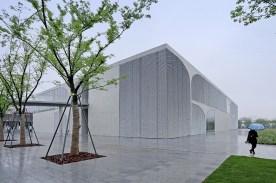 54336da2c07a80cbe80000ef_long-museum-west-bund-atelier-deshaus_view_from_the_riverside