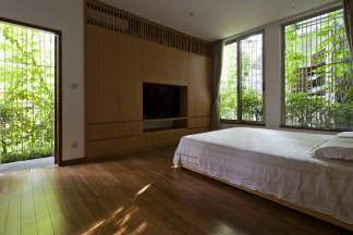53e02277c07a8018740000fb_green-renovation-vo-trong-nghia-architects_pic08_bedroom_oki