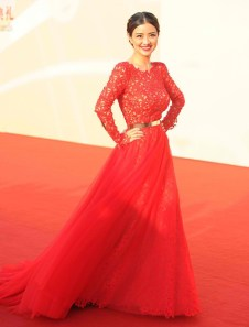 Jing Wei -- one of the nights few Best Dressed in a sexy bare back red gown accentuated with a slim gold belt