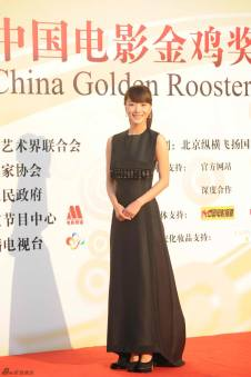 Wang Luo Dan in a classic black gown.