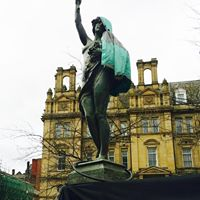 Lady Justice Stands with the Couriers