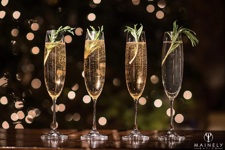 Champagne cocktail with St Germain elderflower liquor and fresh rosemary