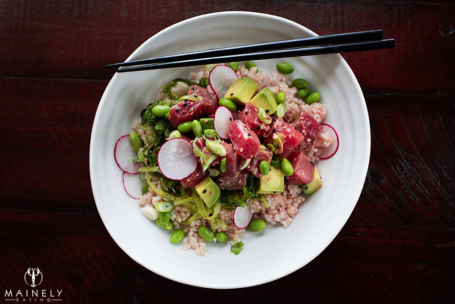 Ahi tuna poke bowl with brown sprouted rice, seaweed salad, edamame and radish by MainelyEating.com