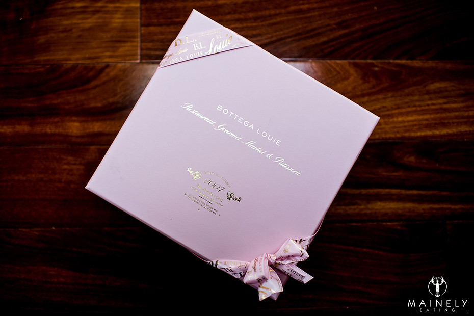 Beautifully wrapped box of macarons by Bottega Louie