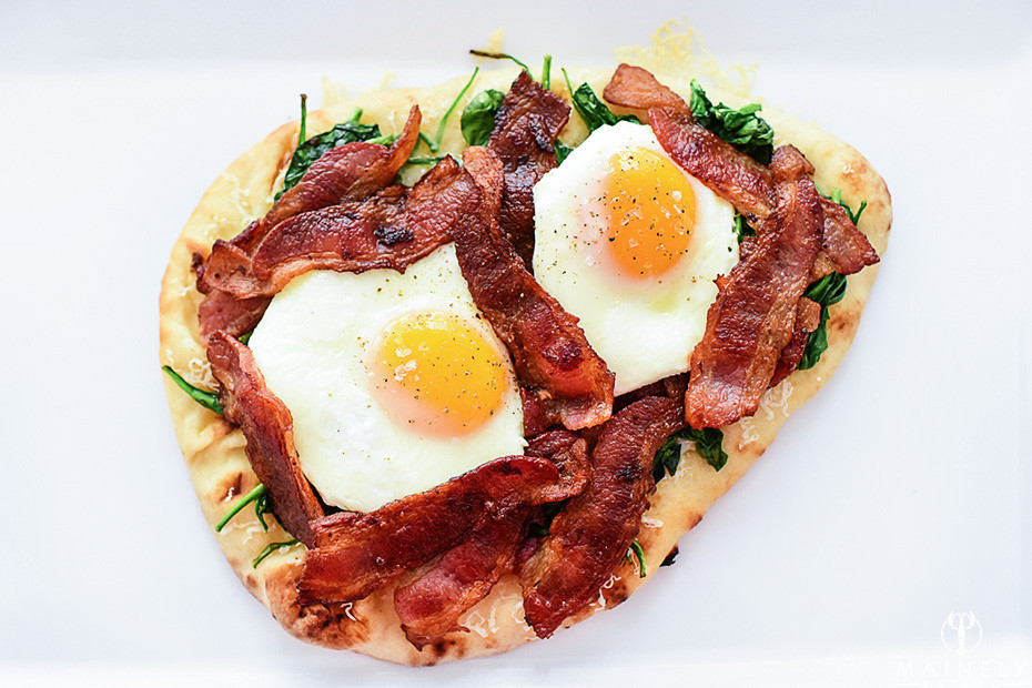 Quick and easy breakfast pizza with stonefire naan, bacon, spinach, cheese and sunny side up eggs