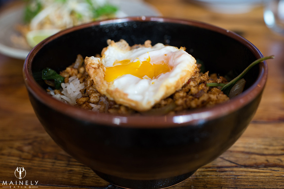 Thai crispy chicken with fried egg on top of white rice at Long Grain by MainelyEating.com