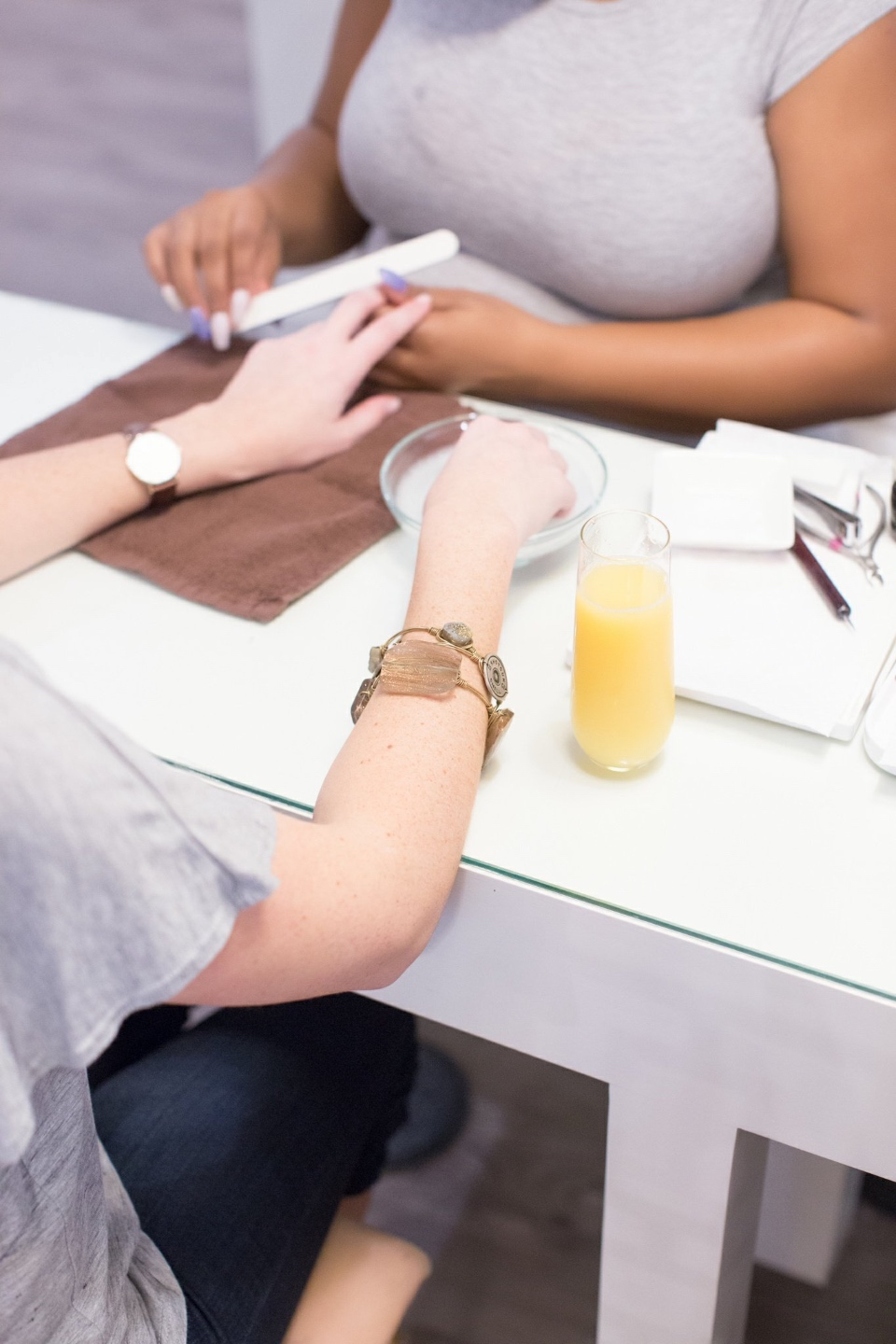Girls Day Out In Raleigh by popular NC lifestyle blog, I'm Fixin' To: image of a woman getting her nails done.