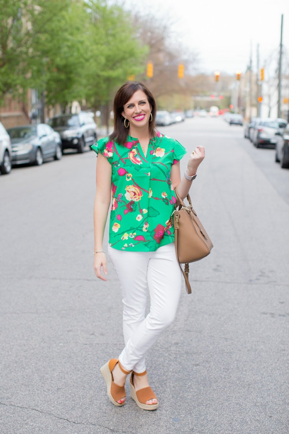J.Crew Factory Floral Top featured by top US fashion blog I'm Fixin' To; Image of a woman wearing J. Crew Factory floral top, J. Crew high-waisted jeans, Steve Madden wedges, Tory Burch tote, Sheila Fajl hoops, David Yurman bangle and Moon & Lola Cheshire necklace.