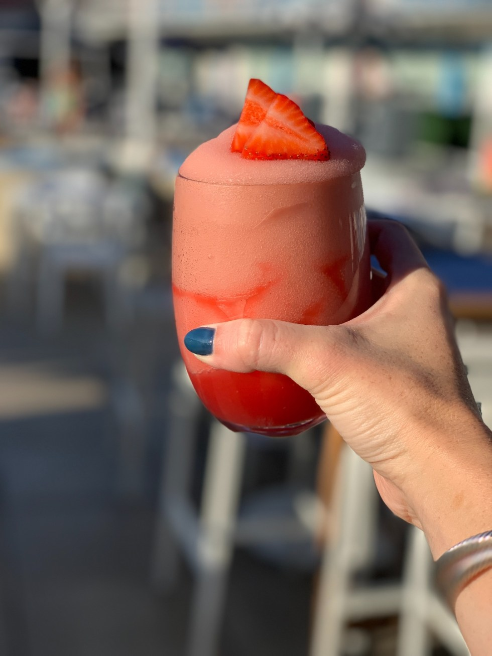 Things to do in Durham by popular NC travel blog, I'm Fixin' To: image of a woman holding a strawberry frose.