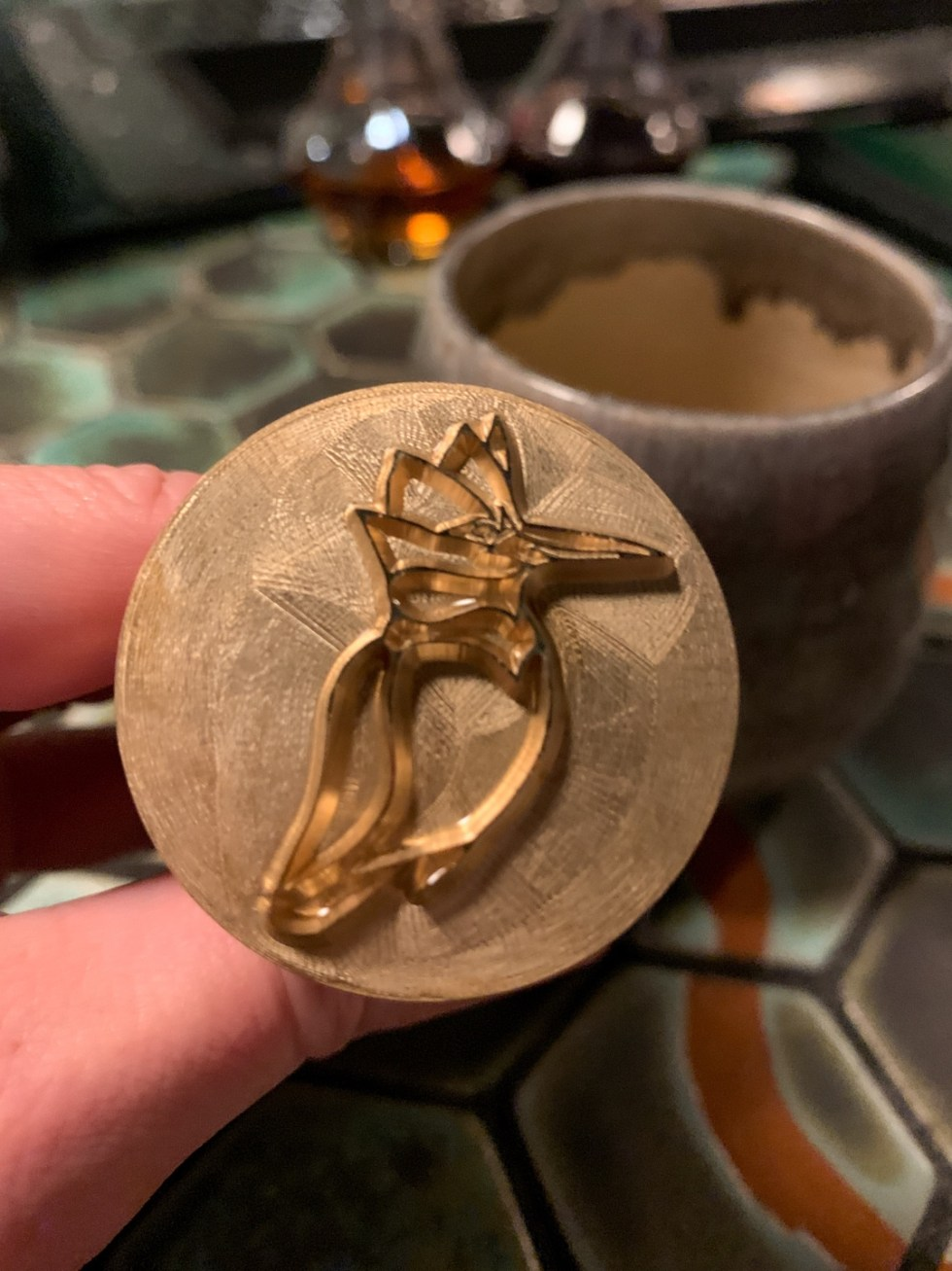 23 Awesome Things To Do in Durham - I'm Fixin' To - @imfixintoblog | Things to do in Durham by popular NC travel blog, I'm Fixin' To: image of a woman holding  lid with a metal bird decal on it.
