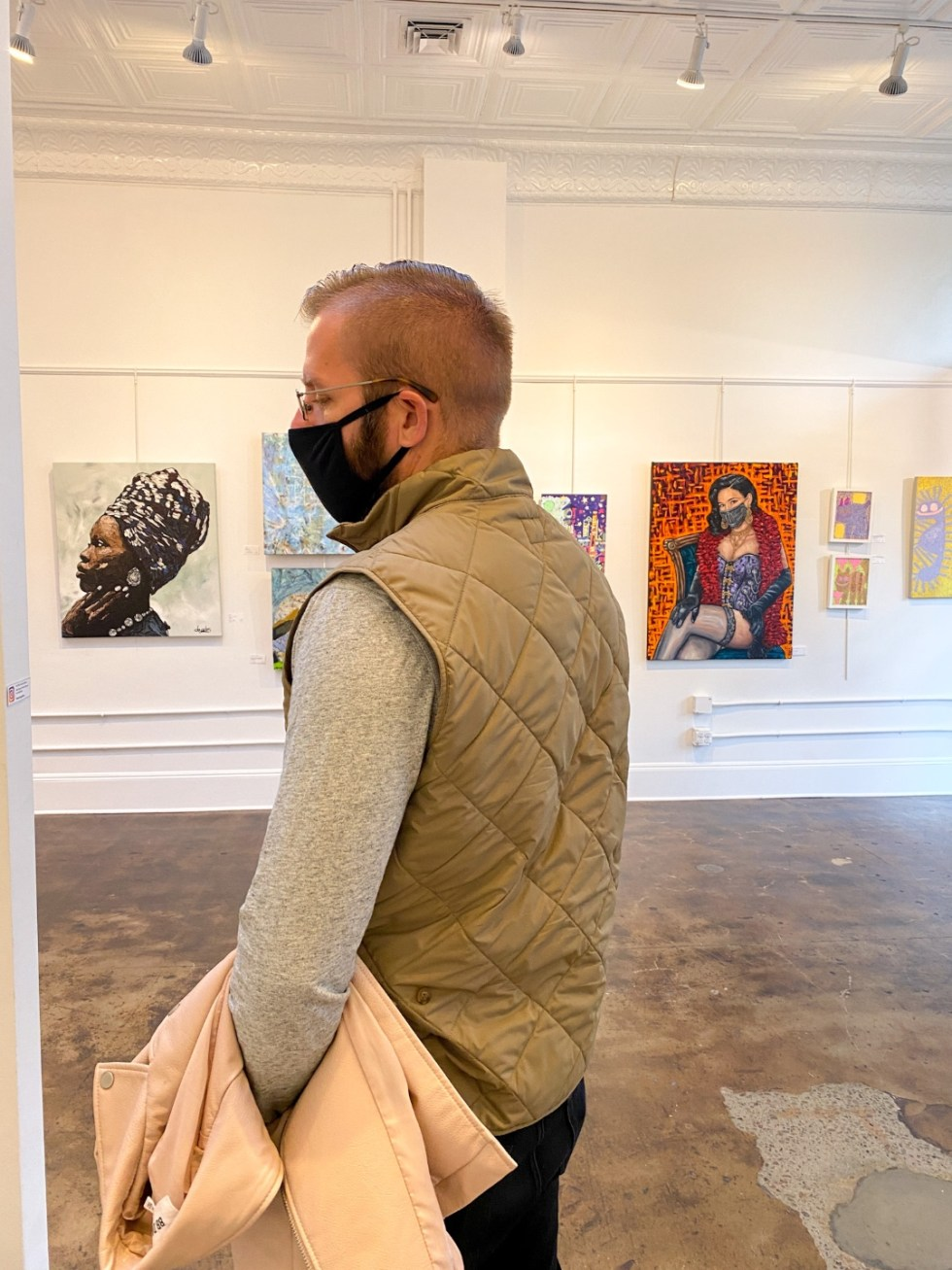 23 Awesome Things To Do in Durham - I'm Fixin' To - @imfixintoblog | Things to do in Durham by popular NC travel blog, I'm Fixin' To: image of a man walking through a Durham art gallery.