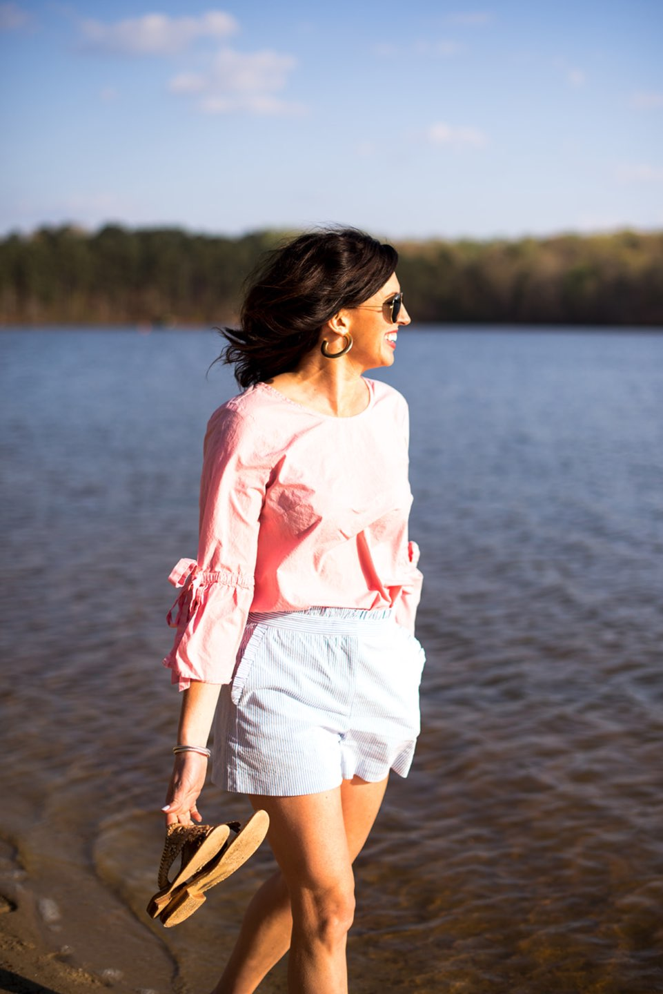 Casual Spring Outfits featured by top US fashion blog I'm Fixin' To; Image of a woman wearing J. Crew Factory Linen Tie Top, J. Crew Factory Seersucker Shorts, David Yurman Bangle, Sheila Fajl Hoops, Ray-Ban Polarized Aviators and Jack Rogers Sandals.