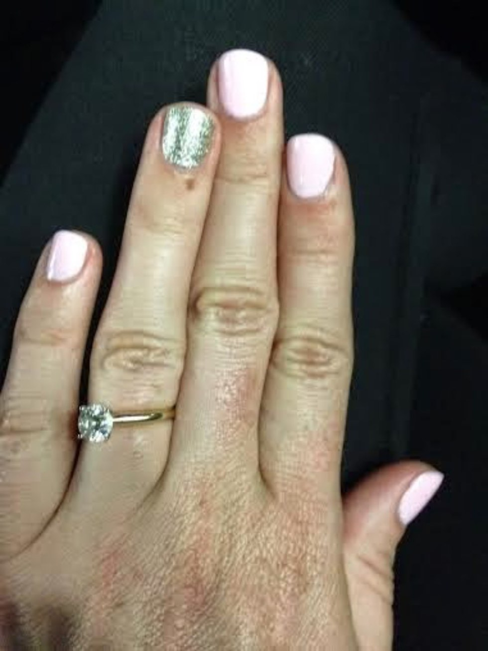 9 Best Nail Polish Colors for Warm Weather - I'm Fixin' To - @mbg0112 | Top 10 Best Summer Nail Polish Colors by popular North Carolina blog, I'm Fixin' To: image of a manicured hand with Essie Fiji on the nails.