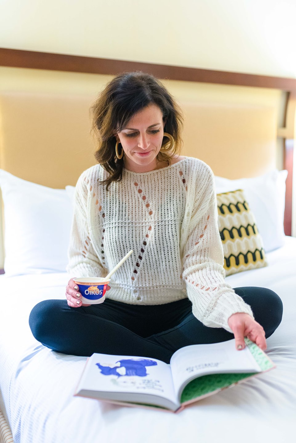 A Quick Dessert Idea that Will Satisfy your Cravings - I'm Fixin' To - @mbg0112 | Oikos, a quick desert idea that will satisfy your sweet cravings, featured by top US lifestyle blog, I'm Fixin To: image of a woman eating an Oikos yogurt