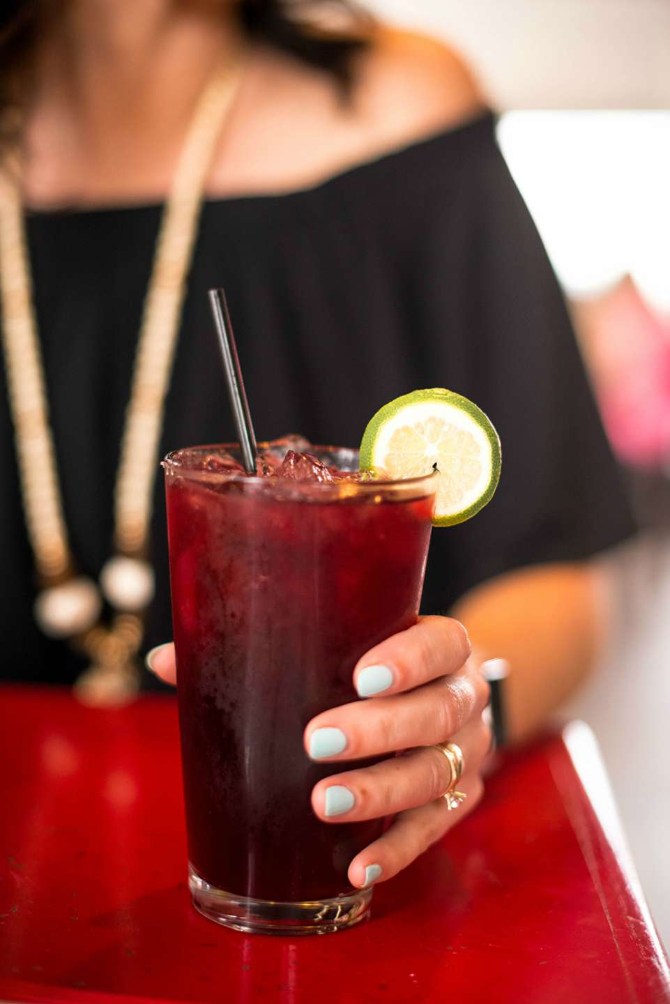 Top 10 most popular posts of 2018 featured by top North Carolina life and style blog, I'm Fixin' To: image of a woman holding a cocktail