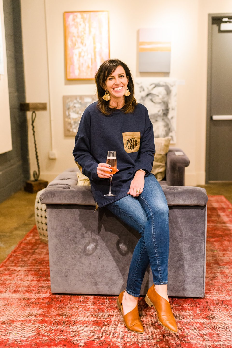 The Monogrammed Sweatshirt Trend with Marley Lilly featured by top US life and style blog, I'm Fixin' To: image of a woman wearing a Marley Lilly monogrammed sweatshirt, Madewell skinny jeans, Target flats and Etsy earrings