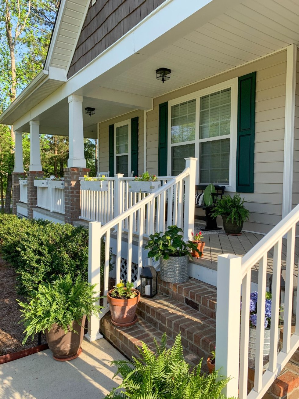 How to Update Your Front Porch Decor for the Season - I'm Fixin' To - @mbg0112  | Front Porch Decor for Spring featured by top US lifestyle blog, I'm Fixin' To: image of plants being planted
