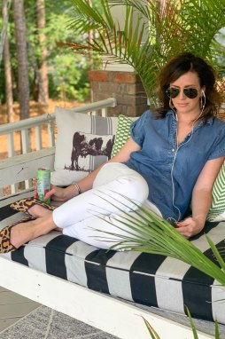 13 Of The Best Podcasts to Listen To featured by top US life and style blog, I'm Fixin' To: image of a woman listening to a podcast