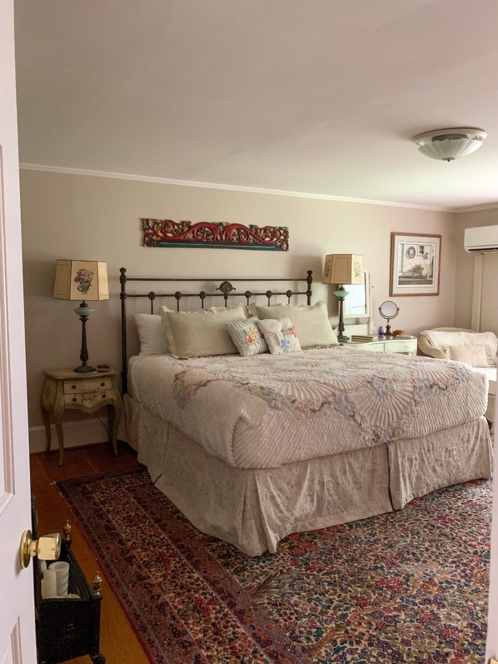 North Carolina Favorite: Between Water and Main Bed & Breakfast in Belhaven - I'm Fixin' To - @mbg0112 | North Carolina Favorite: Between Water and Main Bed & Breakfast in Belhaven by popular North Carolina Blogger, I'm Fixin' To: image of a bedroom with a rustic king size bed and two antique nightstands at the Between Water and Main Bed and Breakfast.