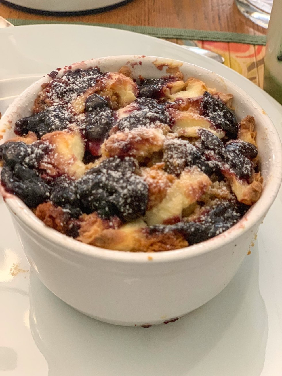 North Carolina Favorite: Between Water and Main Bed & Breakfast in Belhaven - I'm Fixin' To - @mbg0112 | North Carolina Favorite: Between Water and Main Bed & Breakfast in Belhaven by popular North Carolina Blogger, I'm Fixin' To: image of blueberry lemon bread pudding at Between Water and Main Bed and Breakfast.