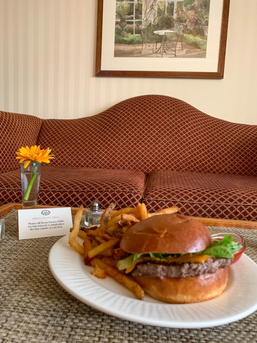 A Night at the O.Henry Hotel In Greensboro, NC - I'm Fixin' To - @mbg0112 |  A Night at the O.Henry Hotel In Greensboro, NC by popular North Carolina blog, I'm fixin' To: image of a room service burger and fries on a white plate at the O. Henry Hotel.