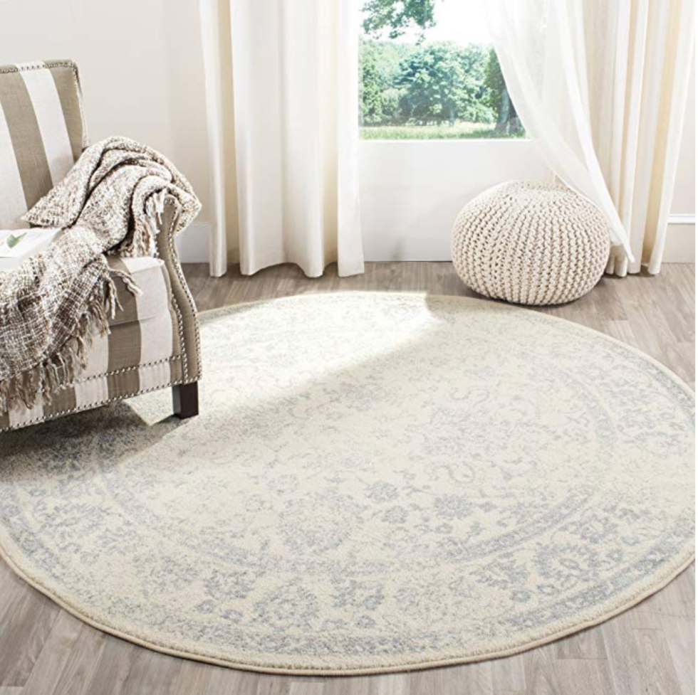 Top 6 Best Area Rugs for your Space from Amazon and Target by popular lifestyle blog, I'm Fixin' To: image of a Safavieh Adirondack Ivory & Slate Round Rug.