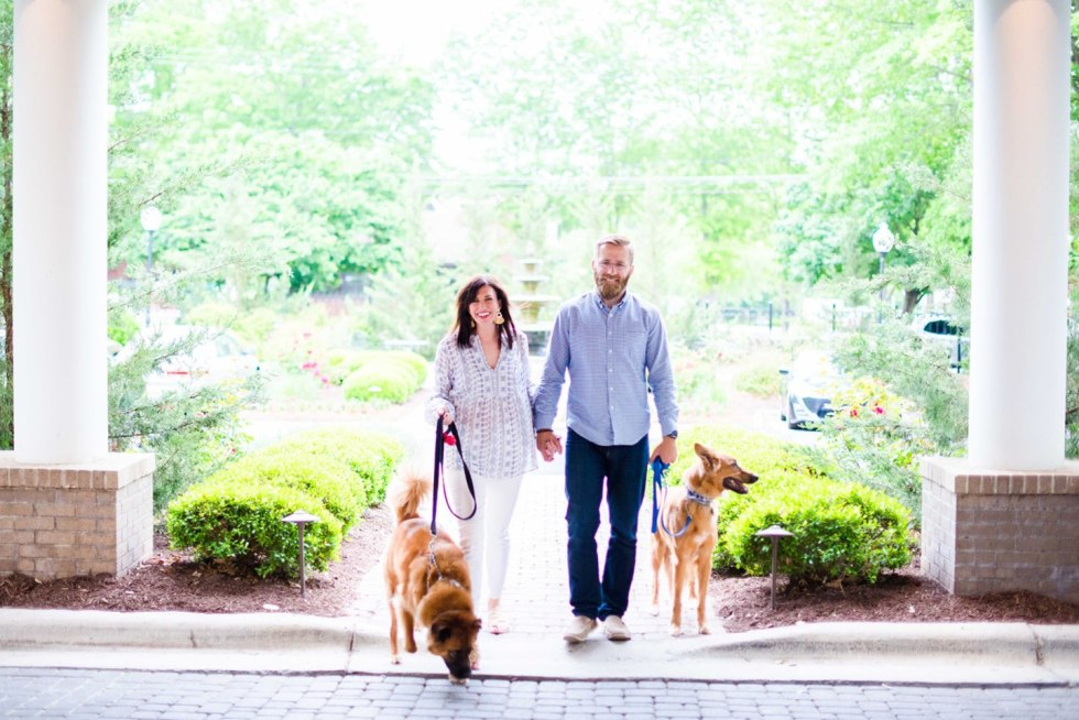 Welcome August + July 2019 Instagram Roundup - I'm Fixin' To - @mbg0112 | Welcome August + July 2019 Instagram Roundup by popular North Carolina life and style blog, I'm Fixin' To: image of a woman and her husband walking their two dogs at the Siena Hotel.