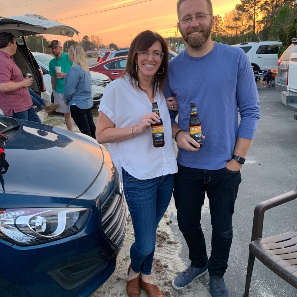 Top 5 Best Destination Restaurants in Eastern NC you Need to Try by popular North Carolina blog, I'm Fixin' To: image of a man and woman standing together outside and holding Patagonia beers at the Beefmastor Inn.