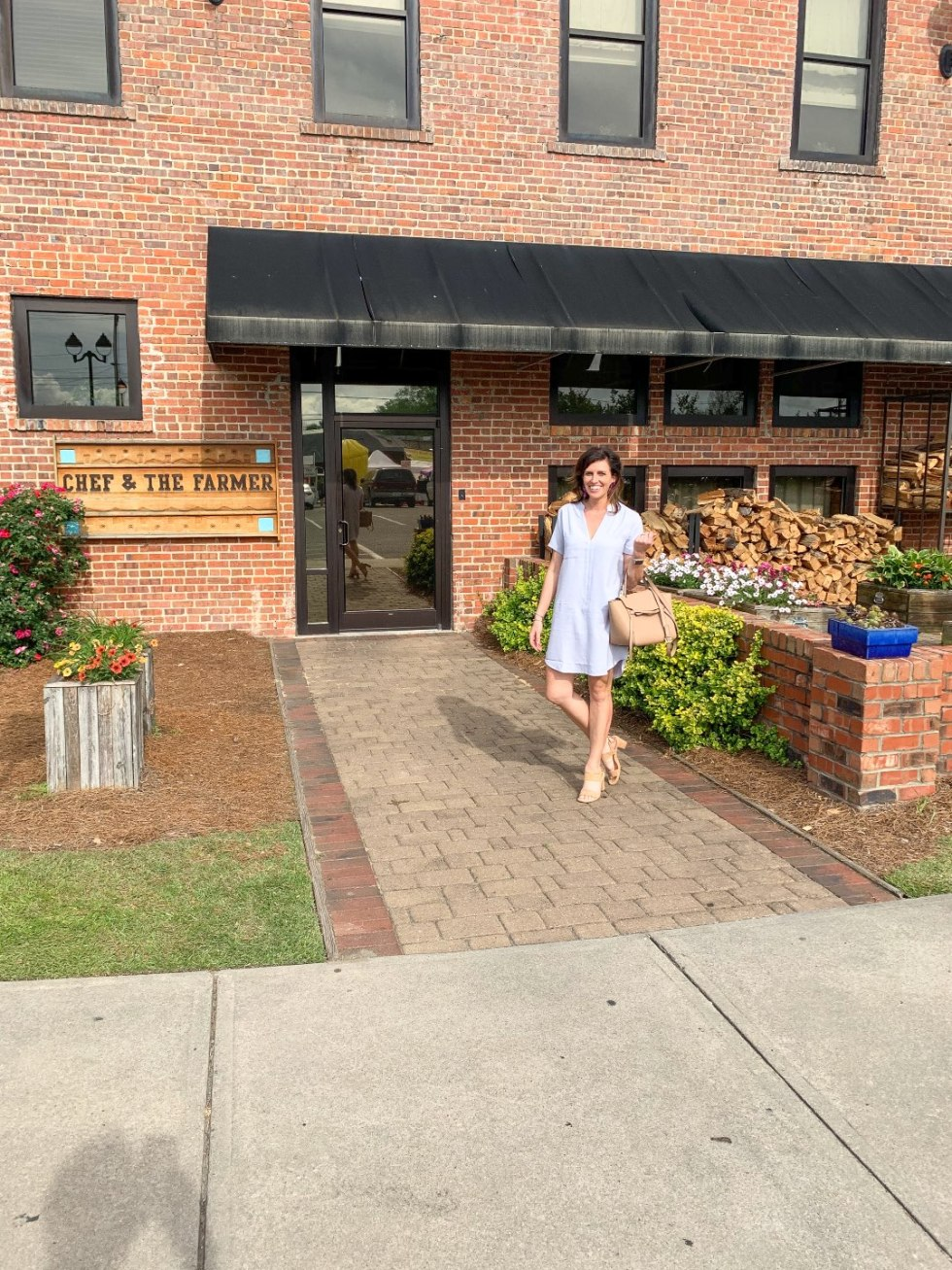 Top 5 Best Destination Restaurants in Eastern NC you Need to Try - I'm Fixin' To - @mbg0112 | Top 5 Best Destination Restaurants in Eastern NC you Need to Try by popular North Carolina blog, I'm Fixin' To: image of a woman standing outside at the Chef and The Farmer.