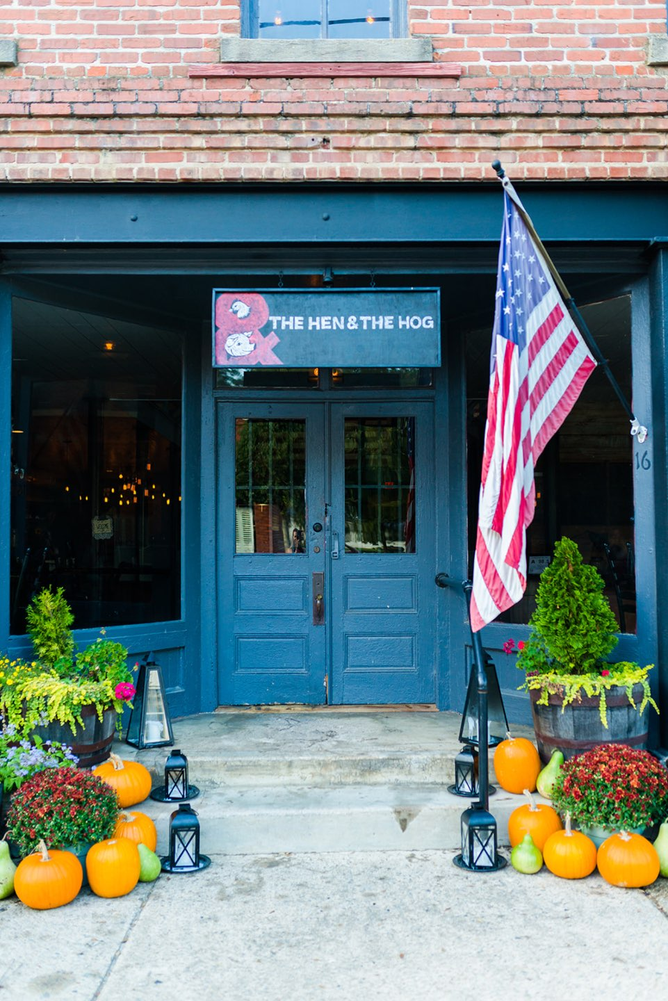 Top 5 Best Destination Restaurants in Eastern NC you Need to Try - I'm Fixin' To - @mbg0112 | Top 5 Best Destination Restaurants in Eastern NC you Need to Try by popular North Carolina blog, I'm Fixin' To: image of The Hen and the Hog entrance.