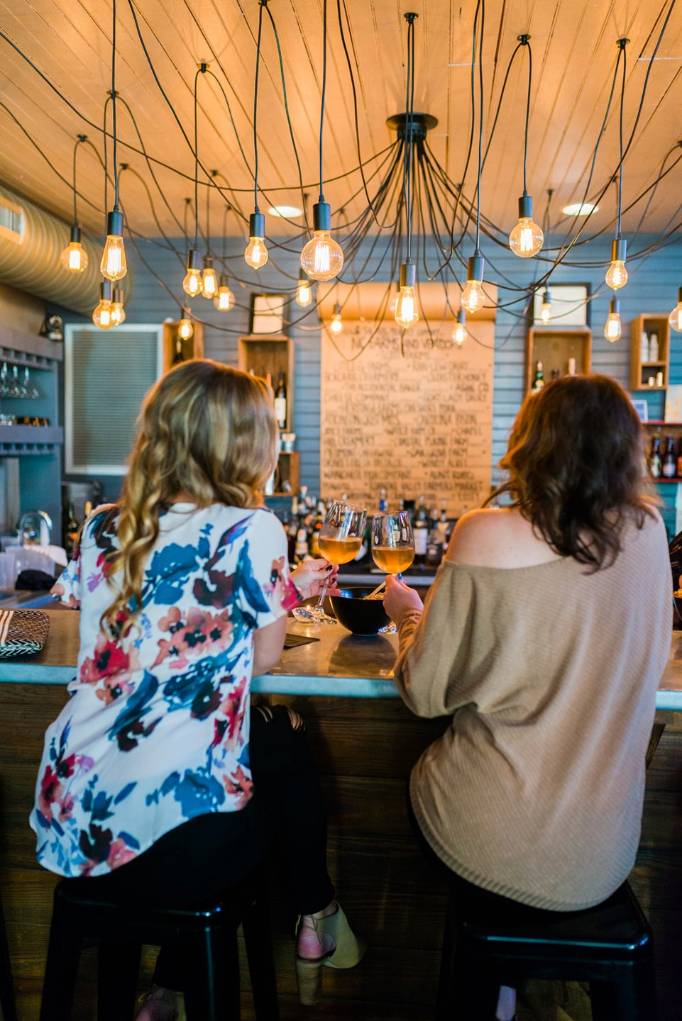 Top 5 Best Destination Restaurants in Eastern NC you Need to Try - I'm Fixin' To - @mbg0112 | Top 5 Best Destination Restaurants in Eastern NC you Need to Try by popular North Carolina blog, I'm Fixin' To: image of the bar at The Hen and the Hog.